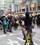 Black-clad protesters gather after Hong Kong police fired tear gas