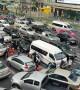 Cars cover zebra crossing during rush hour traffic in Bangkok