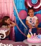 Sisters Fighting to Blow Out the Birthday Candle